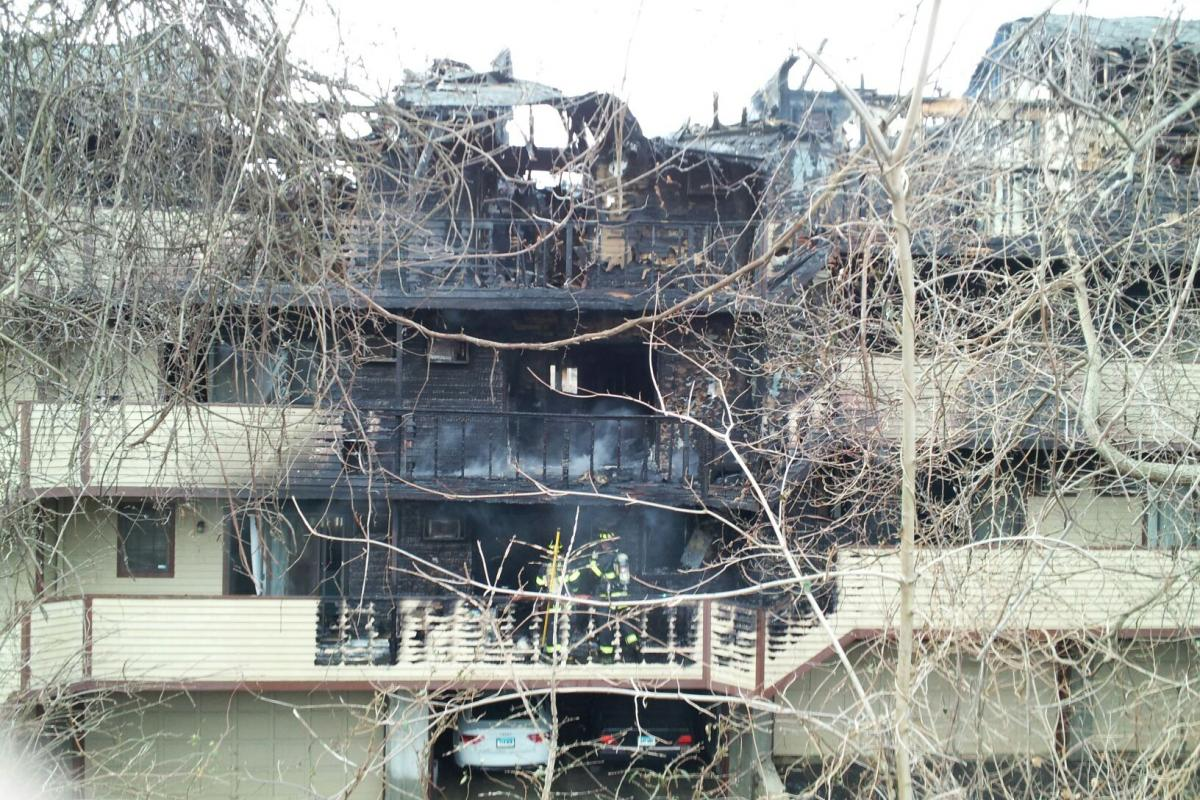 Apartment complex with part of it destroyed after a fire